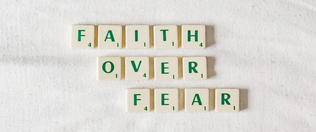 Faith Over Fear spelled out in scrabble tiles