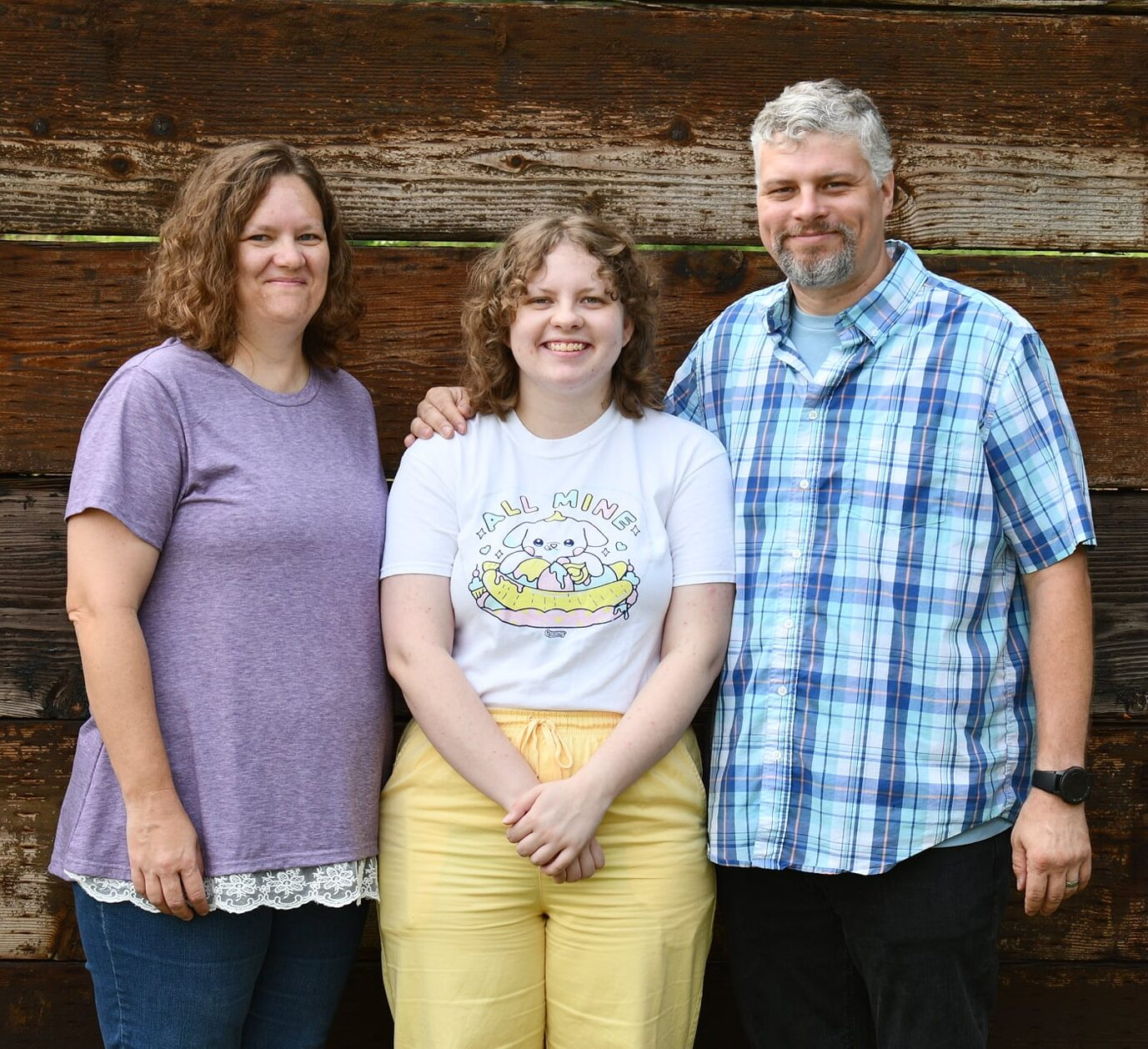 Trey Murray with his wife and daughter
